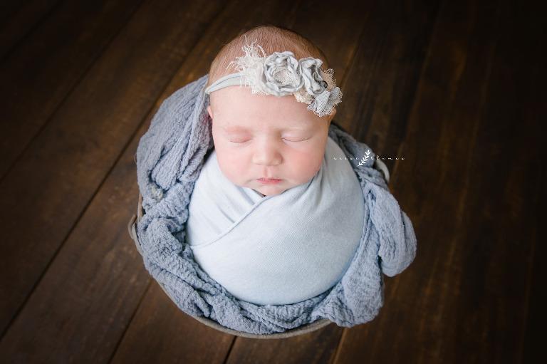 Newborn-Baby-Girl-in-Blue-Bucket-Pose